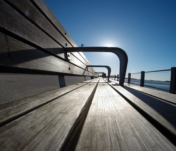 picture of bench in late afternoon blue sky