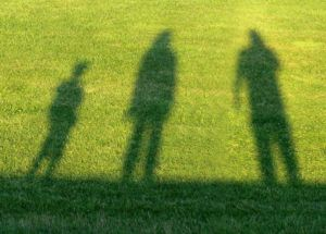 shadow on lawn of family affected by ME/CFS & POTS