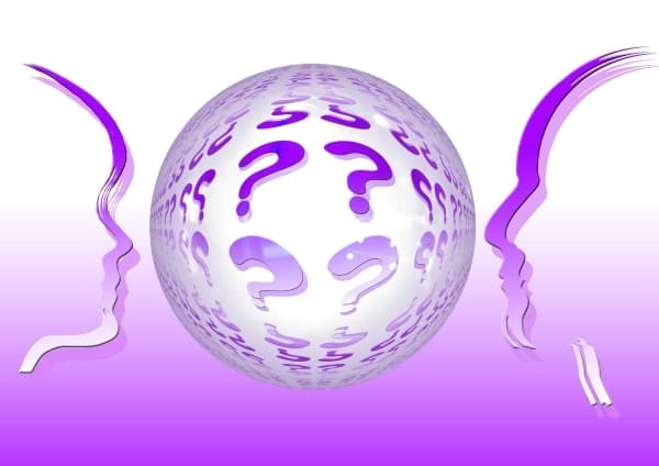 two heads facing a ball of questions marks