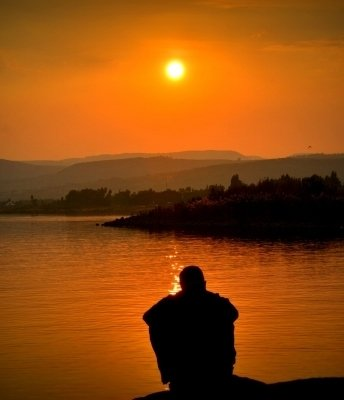 man watching sunset contemplating change